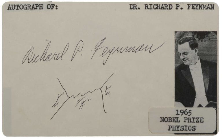 Card bearing Feynman's signature 'Richard P. Feynman', with one of his famous 'Feynman diagrams' below in his hand, and an affixed newspaper photograph of Feynman receiving the Nobel Prize in Physics 1965. Richard Phillips FEYNMAN.